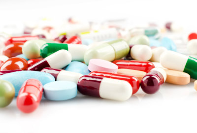 pile of tablets and capsules